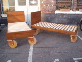 Reclaimed iroko beds on wheels